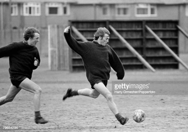 Football March Liverpool player Phil Neal chases teammate Kenny Dalglish during a training session