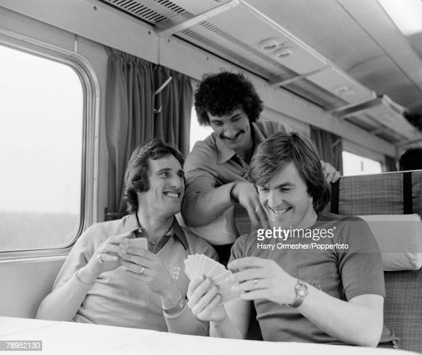 Football 10th March Liverpool players Kenny Dalglish and Ray Clemence watched by Terry McDermott relax by playing cards on the train before their...