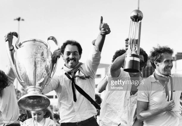 Liverpool goalkeeper Bruce Grobbelaar holds aloft the European Cup trophy as Granme Souness holds the Canon League Division One trophy to thousands...