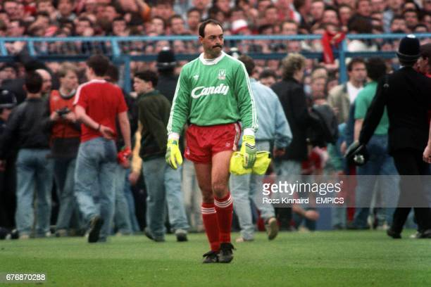 Liverpool goalkeeper Bruce Grobbelaar looks around the ground in disbelief as the tragic events unfold around him 96 people in total lost their lives...