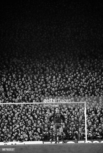 Liverpool goalkeeper Bruce Grobbelaar stands alone in front of a packed Anfield Kop after being beaten by Miroslaw Tlokinski of Widzew Lodz from the...