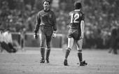 Liverpool goalkeeper Bruce Grobbelaar walks past Liverpool's Steve Nicol looking pensive as he prepares to face the first Roma spot kick from...