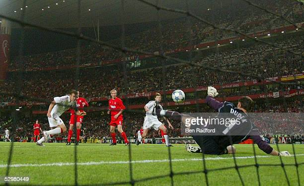 Liverpool goalkeeper Jerzy Dudek of Poland saves a shot from AC Milan forward Andriy Shevchenko of Ukraine during the European Champions League final...