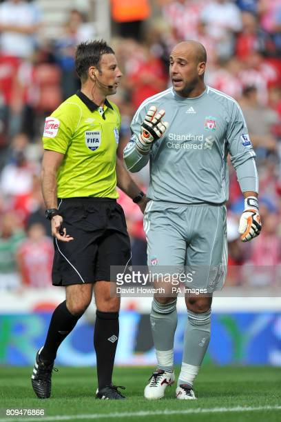 Liverpool goalkeeper Jose Reina argues a point with referee Mark Clattenburg