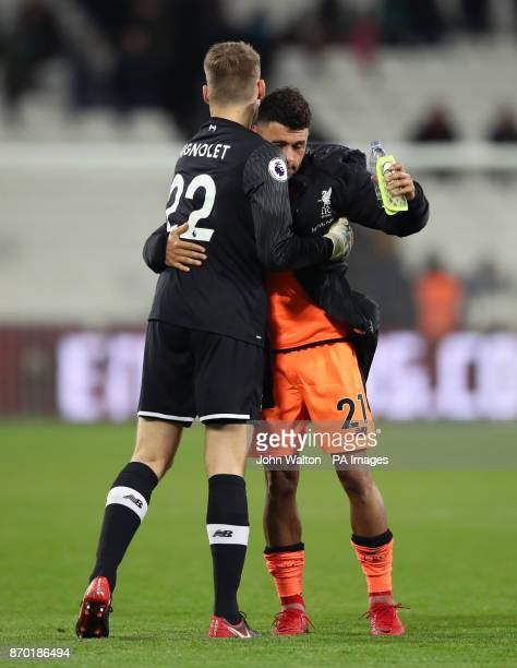 Liverpool goalkeeper Simon Mignolet and Alex OxladeChamberlain celebrate victory after the Premier League match at the London Stadium