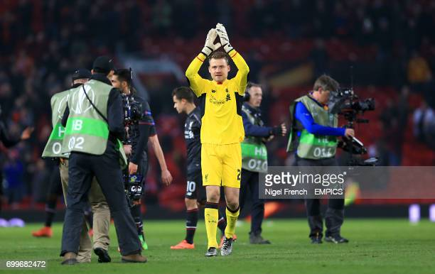 Liverpool goalkeeper Simon Mignolet applauds the fans after the final whistle