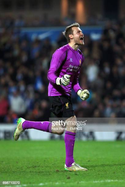 Liverpool goalkeeper Simon Mignolet celebrates as Liverpool win after the final whistle