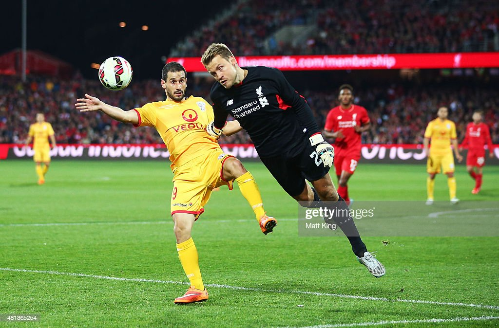 Liverpool goalkeeper <a gi-track='captionPersonalityLinkClicked' href=/galleries/search?phrase=Simon+Mignolet&family=editorial&specificpeople=7124442 ng-click='$event.stopPropagation()'>Simon Mignolet</a> is challenged by Sergio Cirio of United during the international friendly match between Adelaide United and Liverpool FC at Adelaide Oval on July 20, 2015 in Adelaide, Australia.