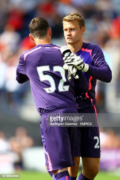 Liverpool goalkeeper Simon Mignolet is replaced by Danny Ward