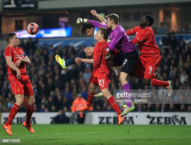 Liverpool goalkeeper Simon Mignolet punches the ball under the challenge of Blackburn Rovers' Rudy Gestede