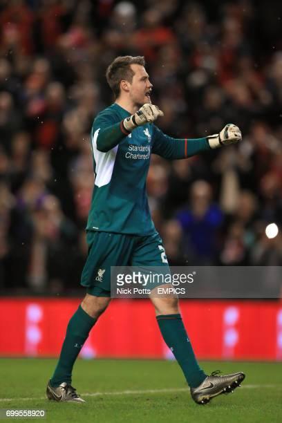 Liverpool goalkeeper Simon Mignolet reacts to team mate Joe Allen scoring the side's winning penalty