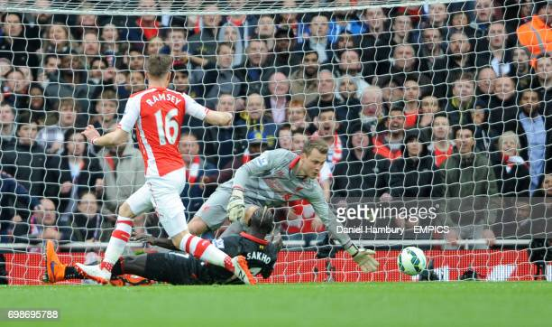 Liverpool goalkeeper Simon Mignolet saves an early shot from Arsenal's Aaron Ramsey