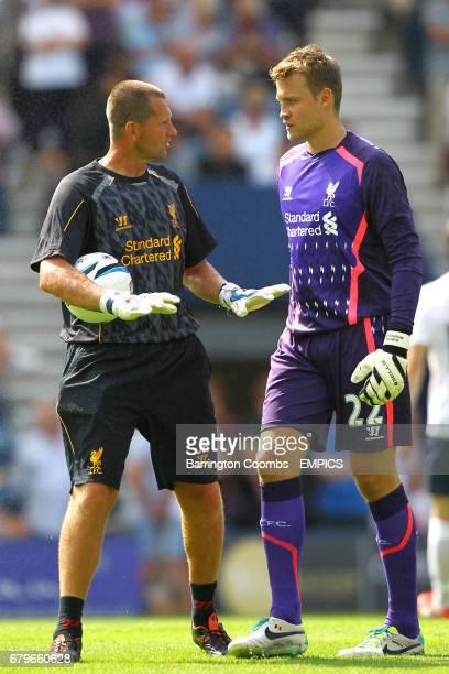 Liverpool goalkeeping coach John Achterberg speaks with goalkeeper Simon Mignolet