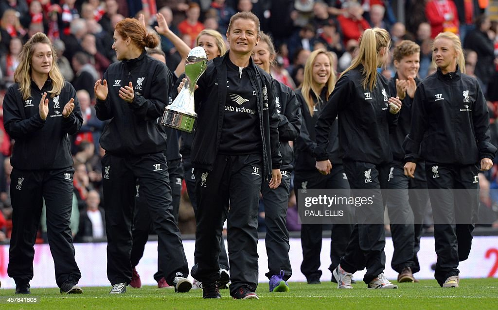 Liverpool Ladies football team players parade with the Women's Premier League trophy before the start of the English Premier League football match...