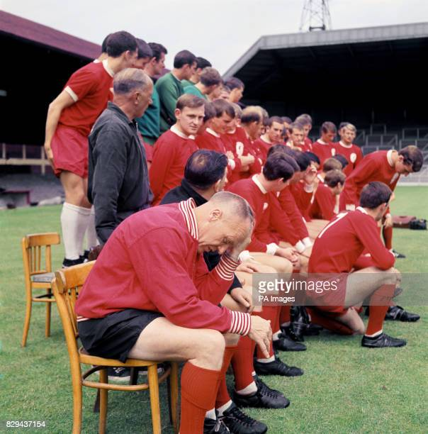 Liverpool manager Bill Shankly feels the stress of a new season as the players and coaches gather for a team group picture