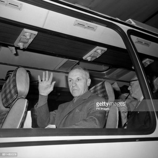 Liverpool manager Bill Shankly greets London with a wave while on the team coach at Euston Station as the Liverpool squad left for their hotel after...