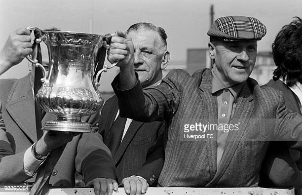 Liverpool manager Bill Shankly in tartan cap holds the winning trophy on the Open Top Bus during the Liverpool FC 1974 FA Cup Victory Parade after...
