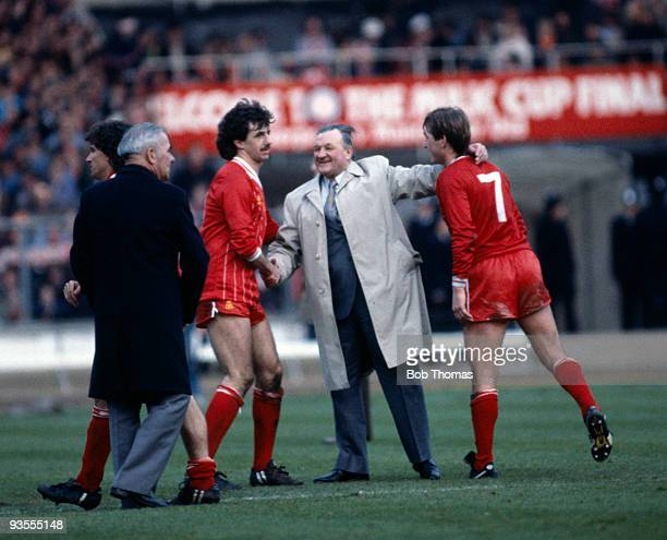 Liverpool manager Bob Paisley congratulates Mark Lawrenson and Kenny Dalglish after Liverpool's victory over Manchester United in the Milk Cup Final...