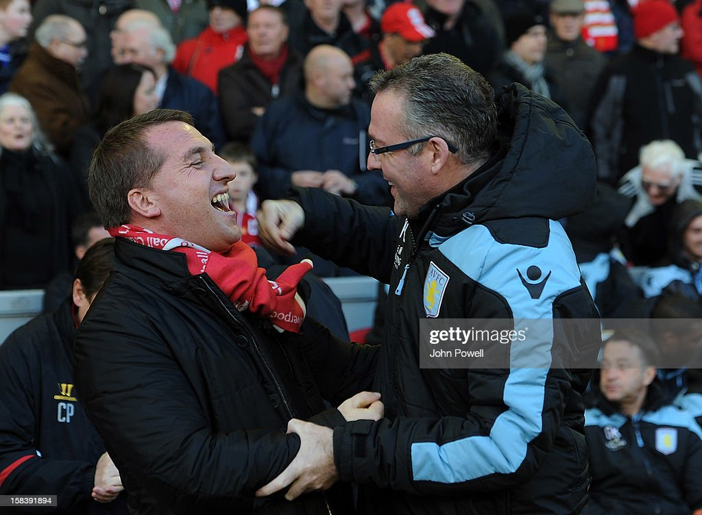 Liverpool manager Brendan Rodgers and Aston Villa manager Paul Lambert share a laugh and a hug before the Barclays Premier League match between Liverpool and Aston Villa at Anfield on December 15, 2012 in Liverpool, England.