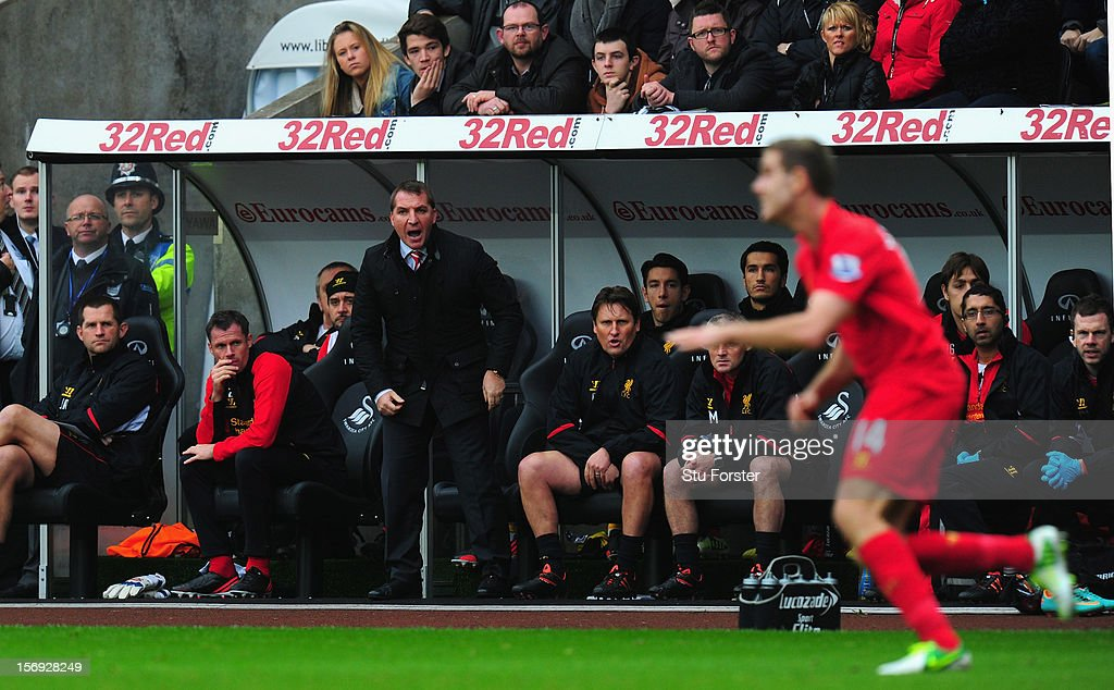 Liverpool manager <a gi-track='captionPersonalityLinkClicked' href=/galleries/search?phrase=Brendan+Rodgers+-+Soccer+Manager&family=editorial&specificpeople=5446684 ng-click='$event.stopPropagation()'>Brendan Rodgers</a> (c) and his bench look on during the Barclays Premier League match between Swansea City and Liverpool at Liberty Stadium on November 25, 2012 in Swansea, Wales.