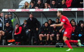 Liverpool manager Brendan Rodgers and his bench look on during the Barclays Premier League match between Swansea City and Liverpool at Liberty...