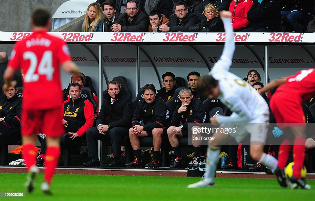 Liverpool manager Brendan Rodgers (c) and his bench look on during the Barclays Premier League match between Swansea City and Liverpool at Liberty Stadium on November 25, 2012 in Swansea, Wales.