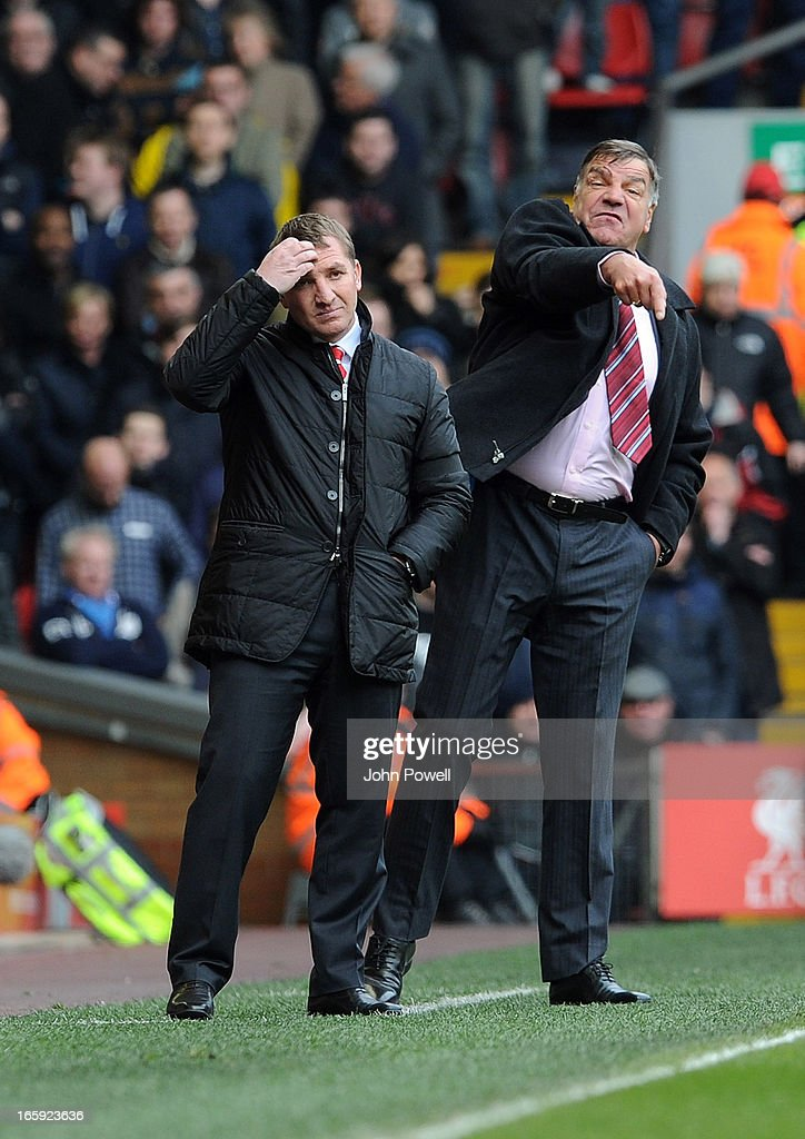 Liverpool manager Brendan Rodgers (L) and West Ham United manager Sam Allardyce react during the Barclays Premier League match between Liverpool and West Ham United at Anfield on April 7, 2013 in Liverpool, England.
