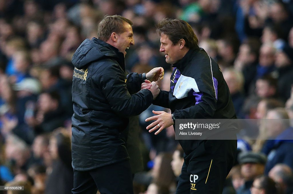 Liverpool Manager Brendan Rodgers celebrates his side's third goal during the Barclays Premier League match between Everton and Liverpool at Goodison Park on November 23, 2013 in Liverpool, England.