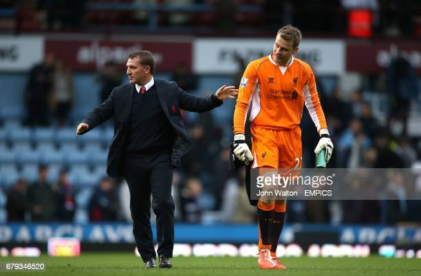 Liverpool manager Brendan Rodgers celebrates victory after the final whistle with goalkeeper Simon Mignolet