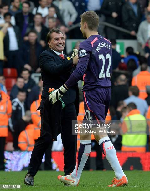 Liverpool manager Brendan Rodgers celebrates with Simon Mignolet after his teams 40 win against Tottenham Hotspur during the Barclays Premier League...