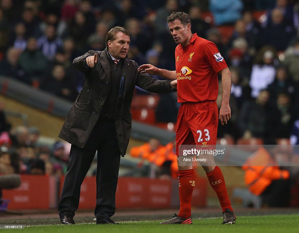Liverpool Manager <a gi-track='captionPersonalityLinkClicked' href=/galleries/search?phrase=Brendan+Rodgers+-+Soccer+Manager&family=editorial&specificpeople=5446684 ng-click='$event.stopPropagation()'>Brendan Rodgers</a> gestures to <a gi-track='captionPersonalityLinkClicked' href=/galleries/search?phrase=Jamie+Carragher&family=editorial&specificpeople=206485 ng-click='$event.stopPropagation()'>Jamie Carragher</a> of Liverpool during the Barclays Premier League match between Liverpool and West Bromwich Albion at Anfield on February 11, 2013 in Liverpool, England.