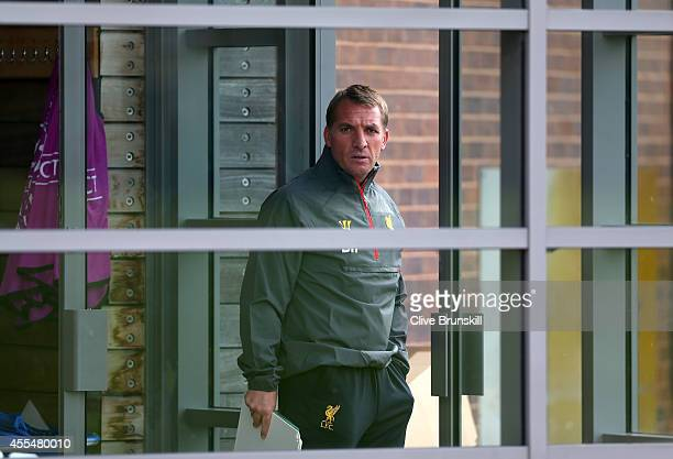 Liverpool manager Brendan Rodgers gets ready to leave the teams Melwood headquarters to take Liverpool's first Champions League open training session...