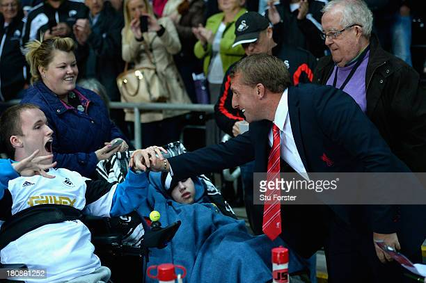 Liverpool manager Brendan Rodgers greets disabled fans before the Barclays Premier League match between Swansea City and Liverpool at Liberty Stadium...