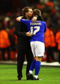 Liverpool manager Brendan Rodgers kisses son Anton Rodgers of Oldham after the Budweiser FA Cup third round match between Liverpool and Oldham...