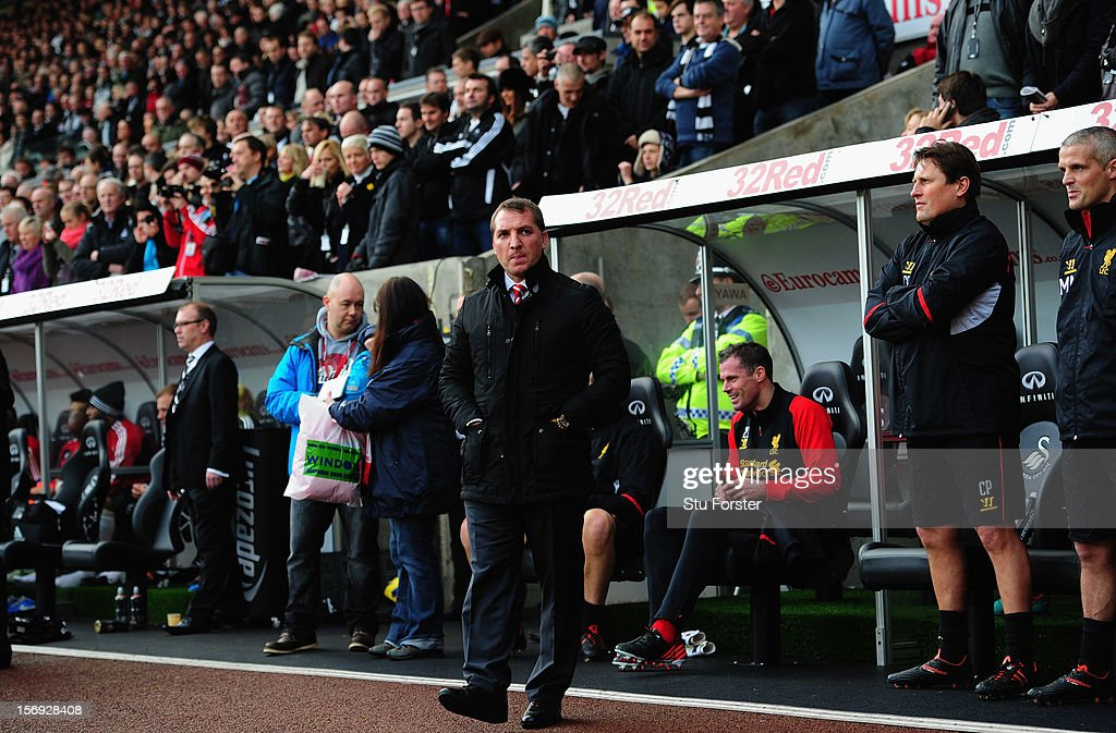 Liverpool manager Brendan Rodgers (c) looks on before the Barclays Premier League match between Swansea City and Liverpool at Liberty Stadium on November 25, 2012 in Swansea, Wales.