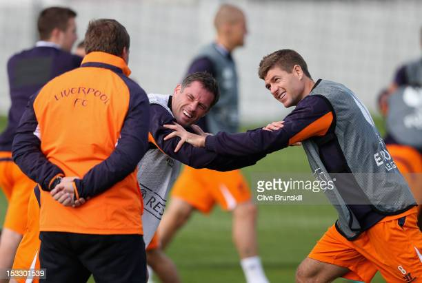 Liverpool manager Brendan Rodgers shares a joke with Jamie Carragher and team captain Steven Gerrard during a training session ahead of their UEFA...