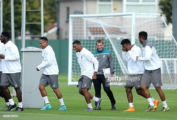 Liverpool Manager Brendan Rodgers smiles at Daniel Sturridge as it appears he forgot to remove his jewelery during a Liverpool FC training session at...