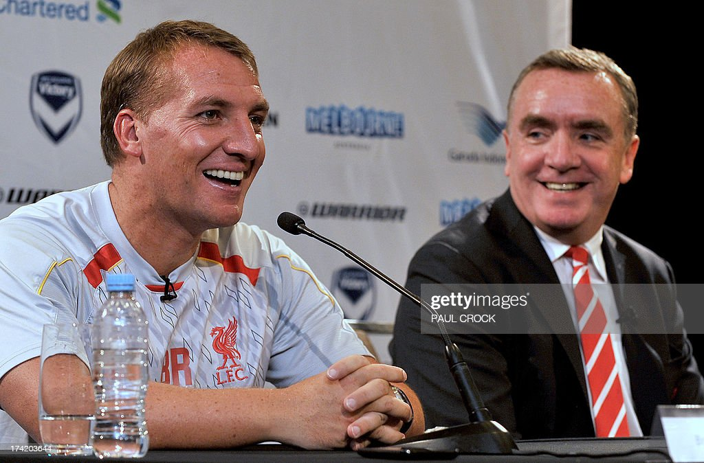 Liverpool manager Brendan Rodgers (L) smiles next to Managing Director Ian Ayre at a press conference in Melbourne on July 22, 2013. Rodgers said on July 22 he expects unsettled star Luis Suarez to stay with the club after the Uruguay striker arrived in Australia to join his teammates in 'great spirits'. AFP PHOTO / Paul CROCK