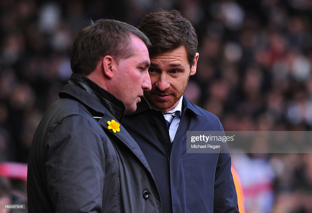 Liverpool manager Brendan Rodgers speaks to Tottenham manager Andre Villas Boas during the Barclays Premier League match between Liverpool and Tottenham Hotspurs at Anfield on March 10, 2013 in Liverpool, England.