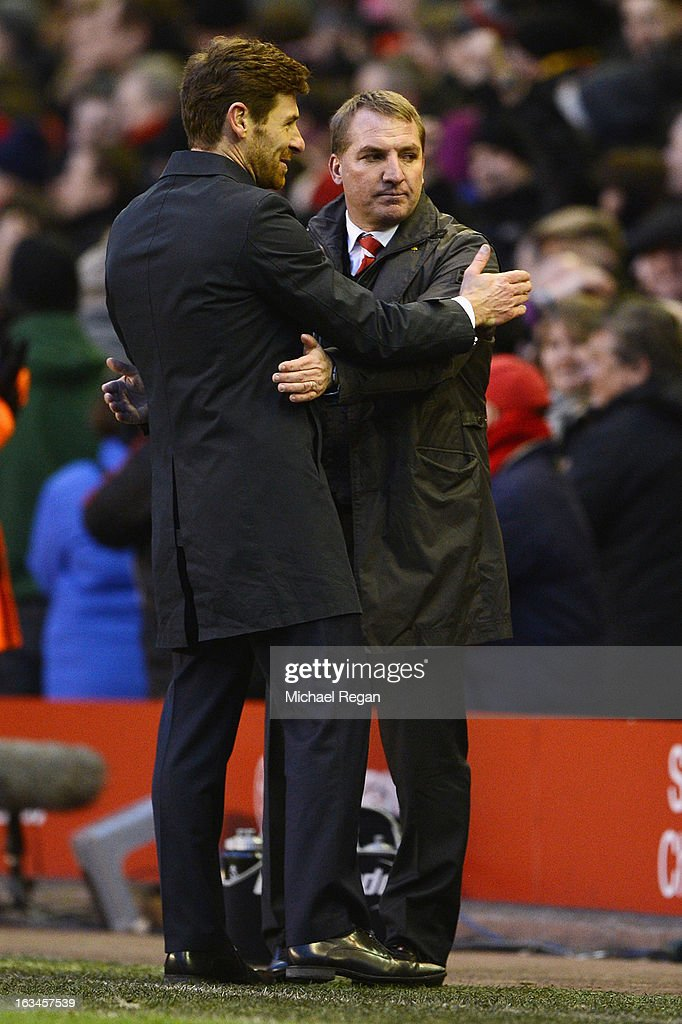 Liverpool manager Brendan Rodgers speaks to Tottenham manager Andre Villas Boas after the Barclays Premier League match between Liverpool and Tottenham Hotspurs at Anfield on March 10, 2013 in Liverpool, England.