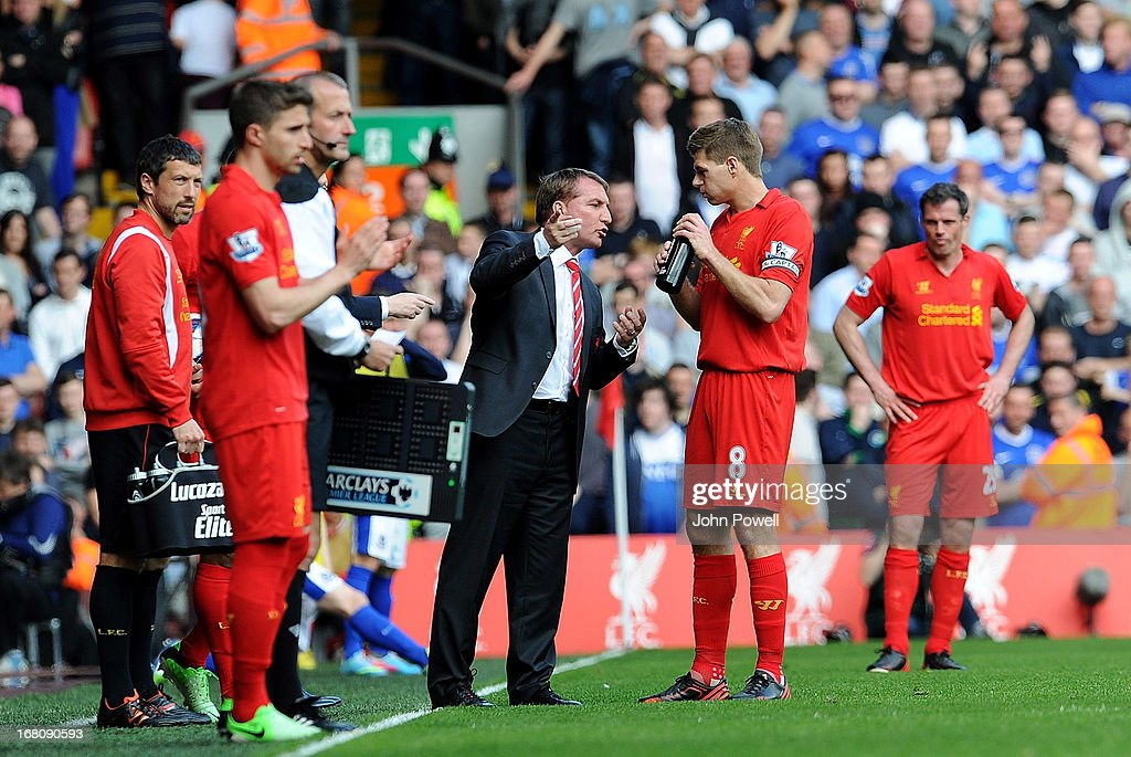 Liverpool manager <a gi-track='captionPersonalityLinkClicked' href=/galleries/search?phrase=Brendan+Rodgers+-+Fotbollstr%C3%A4nare&family=editorial&specificpeople=5446684 ng-click='$event.stopPropagation()'>Brendan Rodgers</a> talks to <a gi-track='captionPersonalityLinkClicked' href=/galleries/search?phrase=Steven+Gerrard&family=editorial&specificpeople=202052 ng-click='$event.stopPropagation()'>Steven Gerrard</a> during the Barclays Premier League match between Liverpool and Everton at Anfield on May 5, 2013 in Liverpool, England.