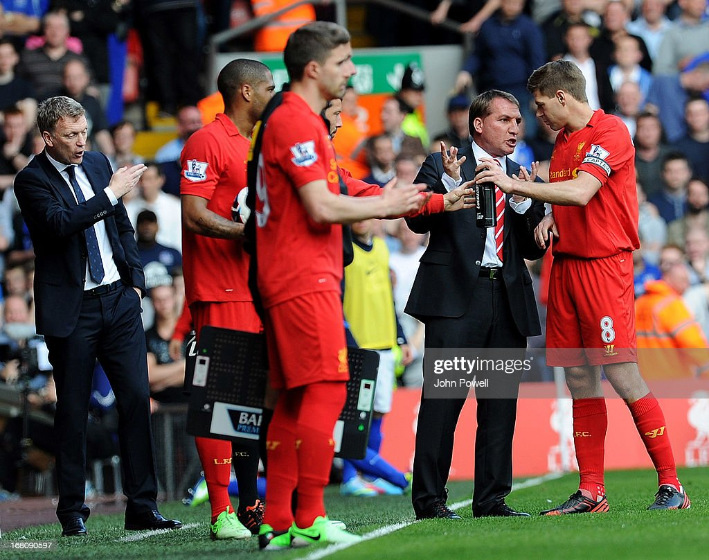 Liverpool manager <a gi-track='captionPersonalityLinkClicked' href=/galleries/search?phrase=Brendan+Rodgers+-+Soccer+Manager&family=editorial&specificpeople=5446684 ng-click='$event.stopPropagation()'>Brendan Rodgers</a> talks to <a gi-track='captionPersonalityLinkClicked' href=/galleries/search?phrase=Steven+Gerrard&family=editorial&specificpeople=202052 ng-click='$event.stopPropagation()'>Steven Gerrard</a> during the Barclays Premier League match between Liverpool and Everton at Anfield on May 5, 2013 in Liverpool, England.