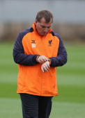 Liverpool manager Brendan Rodgers time keeping during a training session ahead of their UEFA Europa League group match against FC Anzhi Makhachkala...