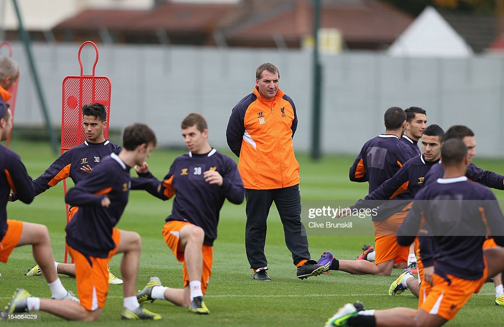 Liverpool manager Brendan Rodgers watches his players during a training session ahead of their UEFA Europa League group match against FC Anzhi...