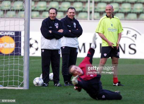 Liverpool manager Gerard Houllier Chief Scout Alex Miller Gary McAllister watch goalkeeper Chris Kirkland during a training session at Bay Arena...