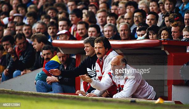 Liverpool manager Graeme Souness with backroom staff Phil Boersma and Ronnie Moran in the Anfield dug out during a match circa 1991 in Liverpool...