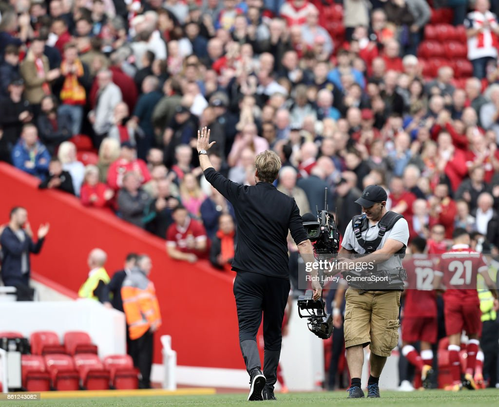Liverpool manager Jurgen Klopp acknowledges the Anfield crowd as he leaves the pitch at the final whistle during the Premier League match between Liverpool and Manchester United at Anfield on October 14, 2017 in Liverpool, England.
