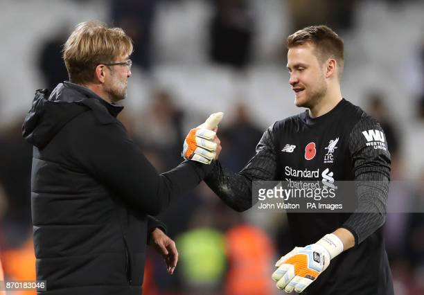 Liverpool manager Jurgen Klopp and goalkeeper Simon Mignolet celebrate victory after the Premier League match at the London Stadium
