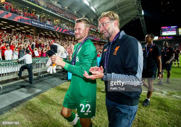 Liverpool manager Jurgen Klopp and Loris Karius walk pass the fans at the Premier League Asia Trophy match after defeating Leicester City FC 21 in...