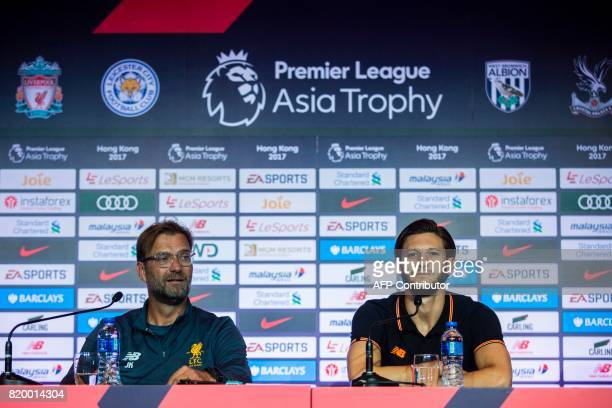 Liverpool manager Jurgen Klopp and player Adam Lallana attend a press conference of the Premier League Asia Trophy football tournament in Hong Kong...